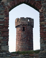 image of a tower through archway